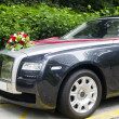 Stock Photo: Wedding car with red ribbons