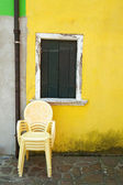 Yellow plastic chairs. — Stock Photo