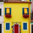 Bright yellow house in Burano. - Stock Photo