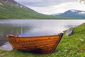 Wooden rowboat at Lapland lake. — Stock Photo