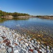 Pebble beach in Stockholm archipelago. — Stock Photo #27147925