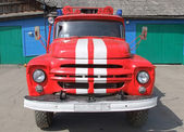 Red with white stripes fire truck — Stock Photo