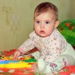 Cute baby plays with toys — Stock Photo