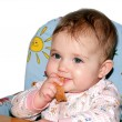Small child at mealtimes — Stock Photo