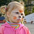 Little girl with painted face — Stock Photo #13321141