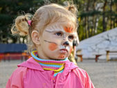 Little girl with painted face — Stock Photo