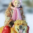 Happy little girl with a dog - Stock Photo