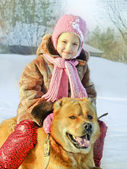 Happy little girl with a dog — Stock Photo