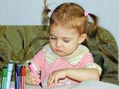Cute child draws felt pen — Stock Photo