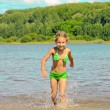 Happy child runs on water — Stock Photo