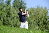 Golf player strikes a good shot — Stock Photo