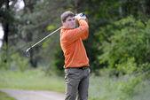 Golf player strikes a good shot — Stock Photo
