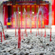 Yellow incense sticks burning in an altar — Foto Stock