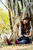 Lady under tree — Stock Photo