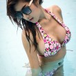 Asian lady wear bikini in swiming pool — Foto Stock