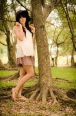 Asian girl in garden — Foto Stock