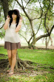 Asian girl in garden — Stock Photo