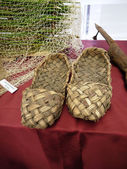 Ancient museum piece of ancient Russian footwear - bast shoes — Stock Photo