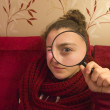 Beautiful tennager girl looking through a magnifying glass - Foto Stock