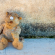 A dirty and old teddy bear - Stock Photo