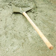 Shovel and wet cement - Stock Photo