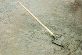 Shovel and wet cement — Stock Photo