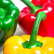 Red, green and yellow peppers — Stock Photo