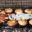 Mushrooms and sea food on barbecue, Greece. - Stock Photo