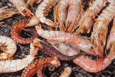 Shrimbs and seafood on barbecue — Stock Photo
