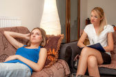 A sexy female psycotherapist treats a teenage female patient — Stock Photo