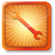 Orange wrench icon — Stock Vector