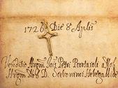 Crucifix on parchment — Stock Photo