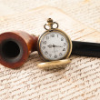 Stock Photo: Pipe and pocketwatch