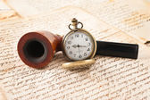 Pipe and pocketwatch — Stock Photo