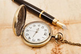 Fountain pen and pocketwatch — Stock Photo