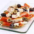 Salad of surimi, olives and cheese; in glass tray - Stock Photo