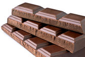 Dark chocolate bars; ordered on white base — Stock Photo