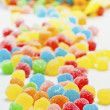 Colored jellybeans covered granulated sugar — Stock Photo #16627091