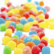 Colored jellybeans covered granulated sugar — Stock Photo #16629805