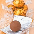 Stock Photo: Group wrapped chocolates in gold