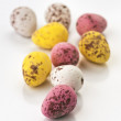 Chocolate balls decorated, furnished and painted eggs — Stock Photo