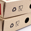 Recycling and fragile symbols printed on a cardboard box — Stock Photo