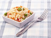Small portion of fried rice in classic tablecloth tables — Stock Photo