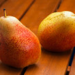 Stock Photo: Two pears on tray in wood grate