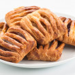Stockfoto: Group flaky pastries filled with jam on white plate