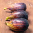 Ripe figs on rustic wooden basis — Stock Photo