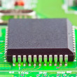 Electronic chip on circuit board — Stock Photo #27738567