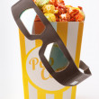 Stock Photo: Candy colored popcorn with 3D glasses