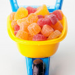 Stock Photo: Toy wheelbarrow full of sugary jellies