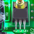 Stock Photo: Anchored transistor and other electronic components mounted on m